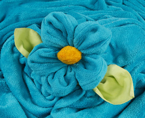 blue terry towel shape of a flower