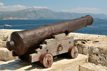 Old cannon at old fortress in medieval town Korcula in Croatia