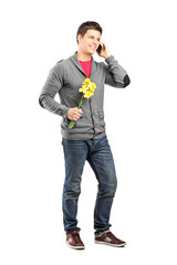 Man holding flowers and talking on the phone