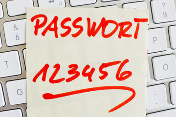 note on computer keyboard: password 123456