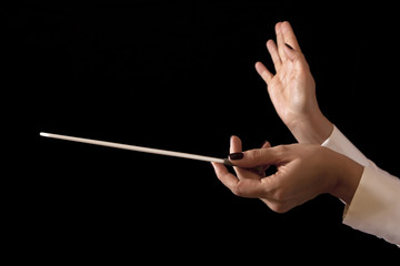 Music director holding stick