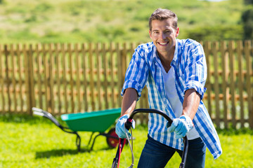 happy man mowing lawn