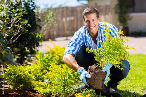 happy young man gardening - 64667170