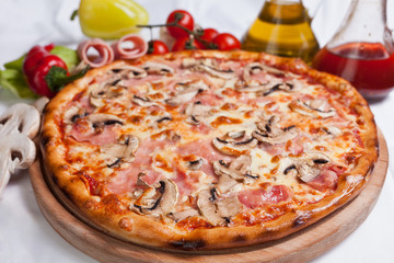 Pizza with mozzarella, ham and mushrooms
