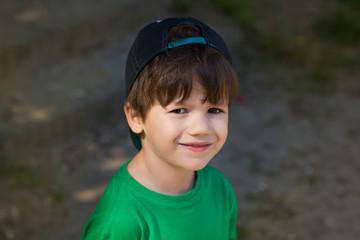 Little boy in cap back smile