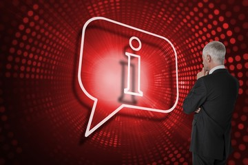 Composite image of speech bubble and businessman looking