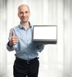 businessman showing blank laptop computer