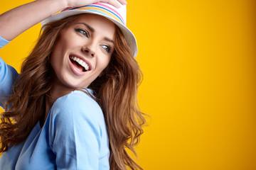 Summer smiling woman in studio portrait