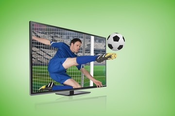 Football player in blue kicking ball through tv screen