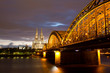 Railway Bridge on Rhine against Cologne Cathedral at night