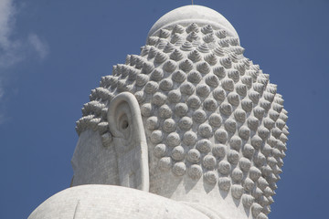 Back of white Buddha statue in Phuket, Thailand