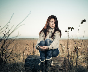 sad girl at fall season meadow