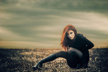 redhead woman at dry field