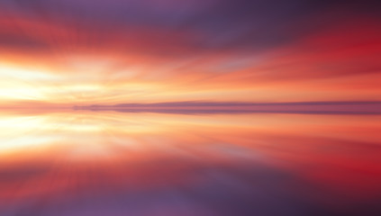 Reflection of colorful sunset clouds with long exposure effect