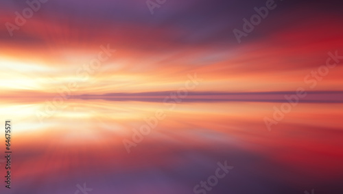 Plexiglas Zonsondergang Reflection of colorful sunset clouds with long exposure effect