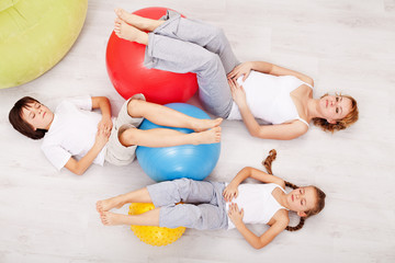 Family relaxing after gymnastic exercise