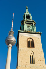 St. Mary's Church and Berlin TV tower against the blue sky