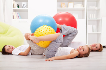 Family exercising with large gymnastic balls