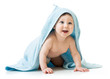 Cute happy baby boy in towel