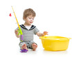 Cute child boy playing with toy rod