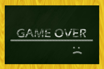 """Blackboard with the words """"game over"""" written"""