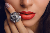 Red lips with the ring. Make up - 64678334
