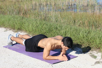 Crossfit training fitness man doing plank