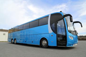 Blue Bus on Parking Lot