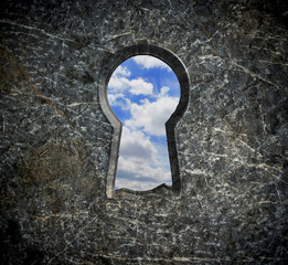 Locking stone over blue sky