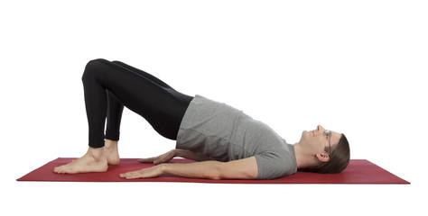 Man doing Bridge pose in yoga