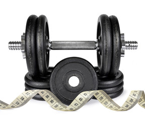 Black dumbbell with measuring tape isolated on white