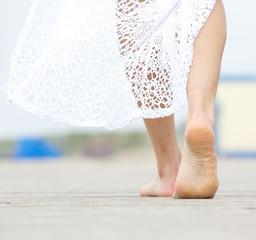 Barefoot woman walking away