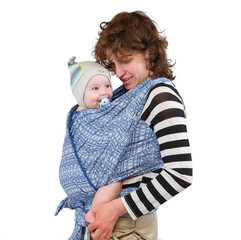 Young mother holding her baby in carrying sling