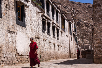 Lhasa, Tibet – April 13, 2009 : Unidentified Lama is walking i