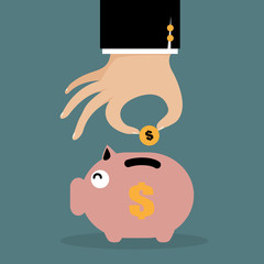 business hand saving money in piggy bank.