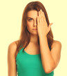 woman brunette girl covered her face half a hand isolated on whi