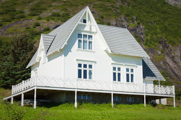 Old wooden architecture in Norway. White home