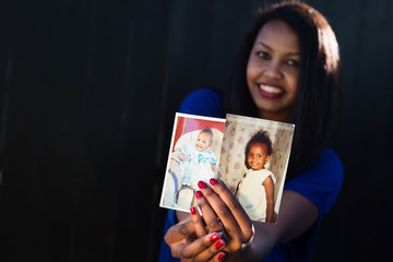 Beautiful girl posing holding her baby pictures
