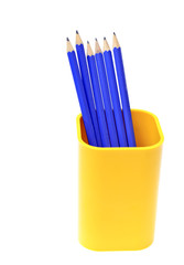 Pencils in support isolated on white