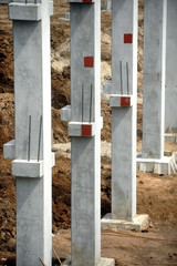 Construction site with concrete pillars