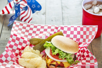 Loaded cheeseburger at a patriotic themed BBQ