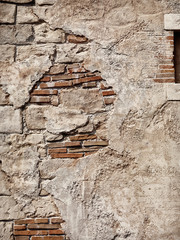 Old rustic stone and brick wall texture