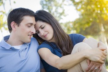 Young Attractive Couple Snuggle in the Park