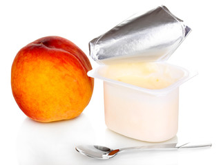 Yogurt with peach isolated on white