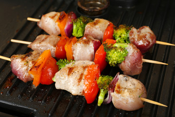 Pork kebab on grill close up