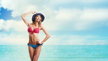 Happy Beautiful Woman In Bikini and hat on the Beach.