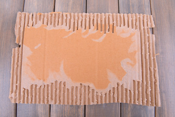 Cardboard on wooden background