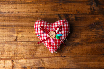 Fabric heart with color pins and safety pins