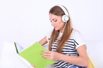 Conceptual image of  audio book. Beautiful girl with book and