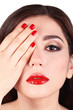 Girl with red lips and nails closeup